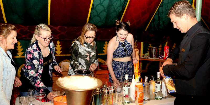 Making cocktails in a private villa at your hen party